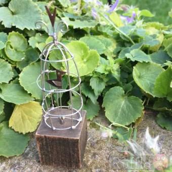 Wire Bird in Cage Sculpture on Driftwood